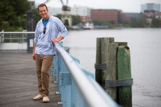 Tim Carr wears a striped hooded shirt from Brooklyn Cloth; blue T-shirt from Gap; tan draw-string khakis from Island Importer and tan hemp shoes from Sanuk.