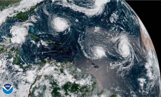 Hurricane Florence can be seen barreling toward the East Coast in this satellite image, followed by another tropical storm and a hurricane. Two other storm systems could form to the north and south.