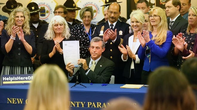 Governor John Carney signed three bills aimed to help fight the opioid and heroin epidemic in Delaware Monday afternoon at the New Castle County Headquarters.