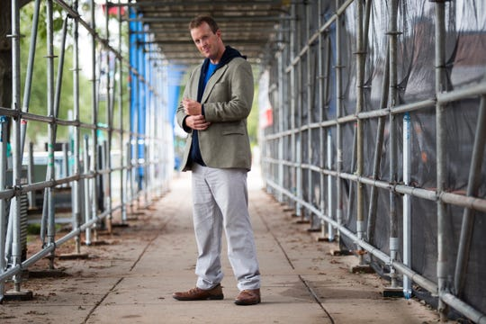 Tim Carr wears a tan sports coat from Jos A Bank; navy hoodie from Gildan; blue T-shirt from Delmarva Blood Bank; Dockers Easy Khaki pants;  and brown dress leather shoes from Sonoma.