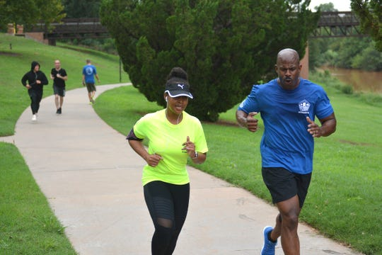 In this file photo, participants run in the annual 9/11 Memorial Run on the Circle Trail shown behind Kay Yeager Coliseum. Another section of the trail was approved for construction to begin from Loop 11 to Lucy Park.