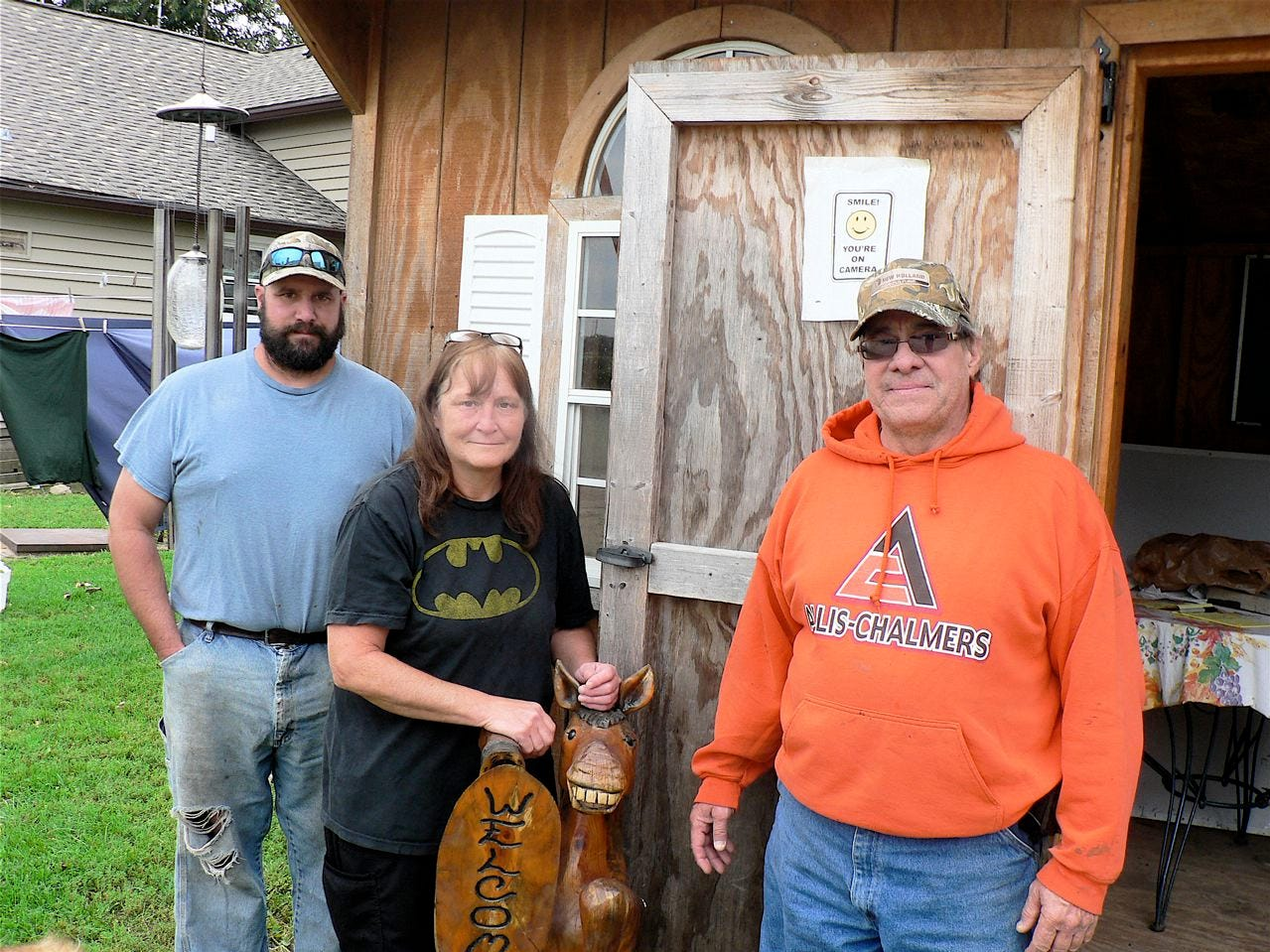 Chad Mayr (left) and his parents, Diane and Gary, run 300 acres of cropland and do a multitude of other things.
