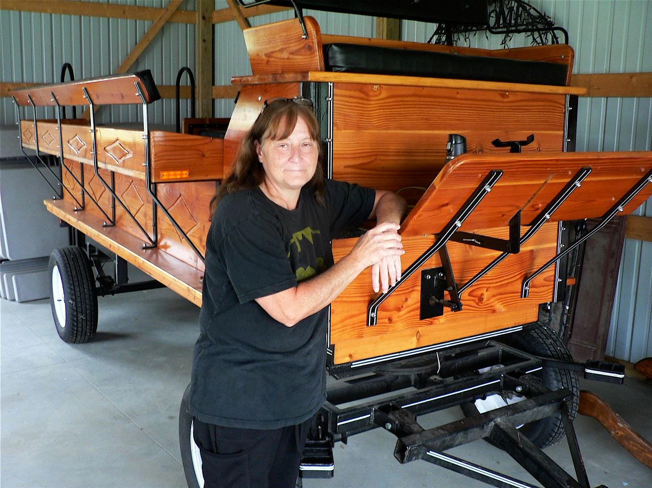 Diane Mayr and her new horse-powered wagon used for rides.