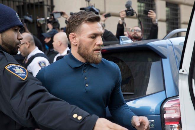 McGregor leaves Brooklyn Criminal Court on April 6.