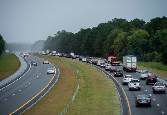 Residents evacuate from coastal areas near Wallace, North Carolina, on Tuesday ahead of Hurricane Florence.