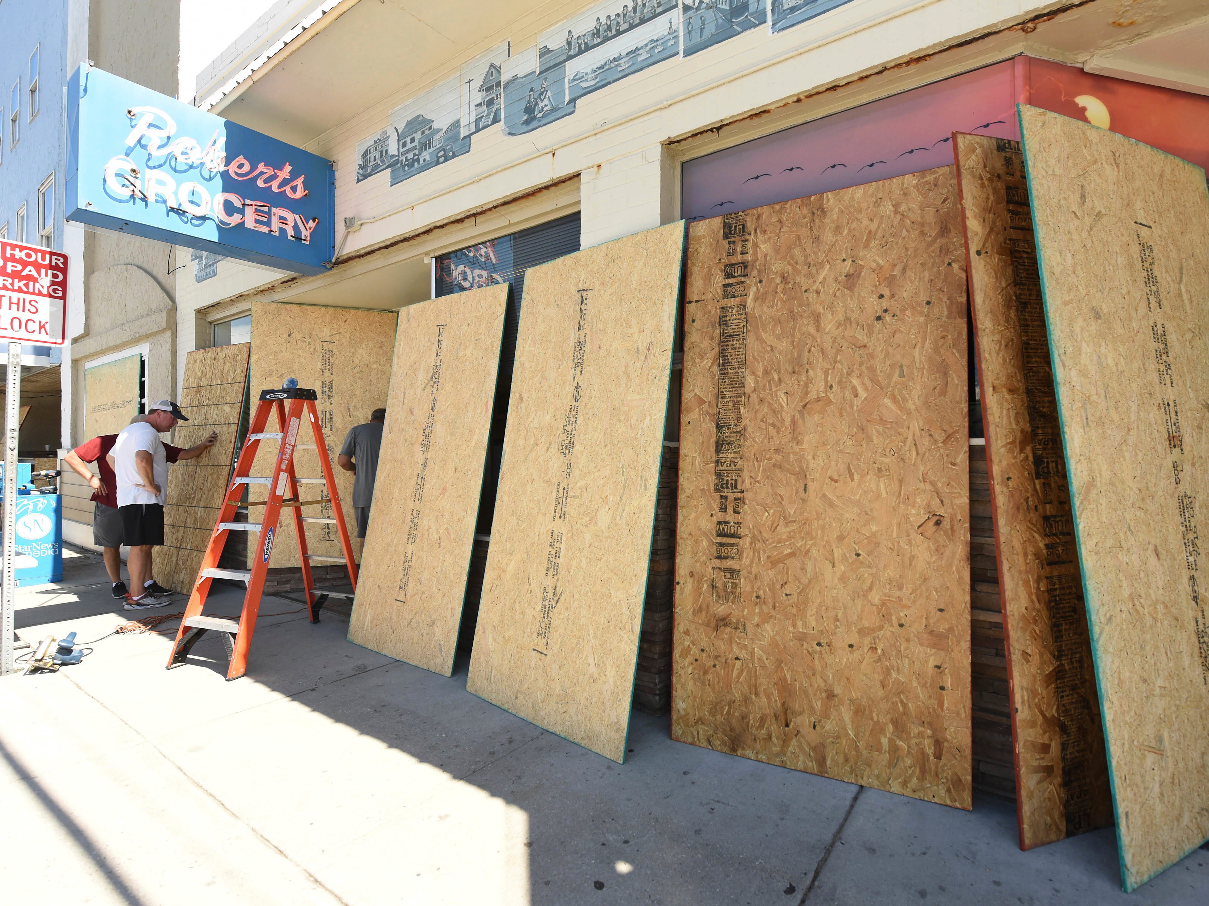 Roberts Grocery Store in Wrightsville Beach, N.C. boards up it's windows as they prepare for Hurricane Florence Monday, Sept. 10, 2018. Hurricane Florence now a category 3 hurricane is expected to make land fall somewhere along the North Carolina coastline towards the end of the week. (Ken Blevins /The Star-News via AP) ORG XMIT: NCWSN103