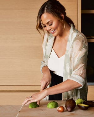 "Chrissy Teigen cuts up in her latest cookbook, ""Cravings: Hungry for More."""