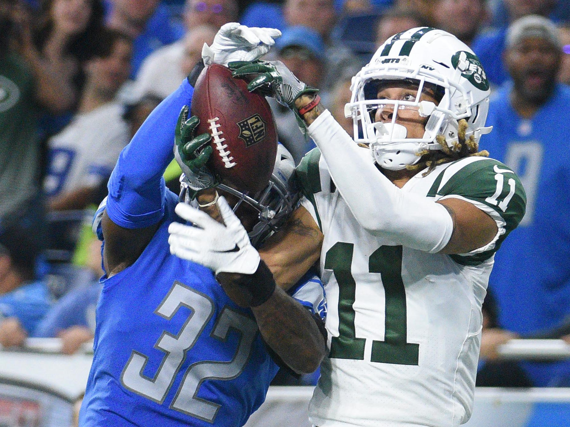 New York Jets wide receiver Robby Anderson catches a pass for a touchdown as Detroit Lions defensive back Tavon Wilson defends during the second quarter at Ford Field.