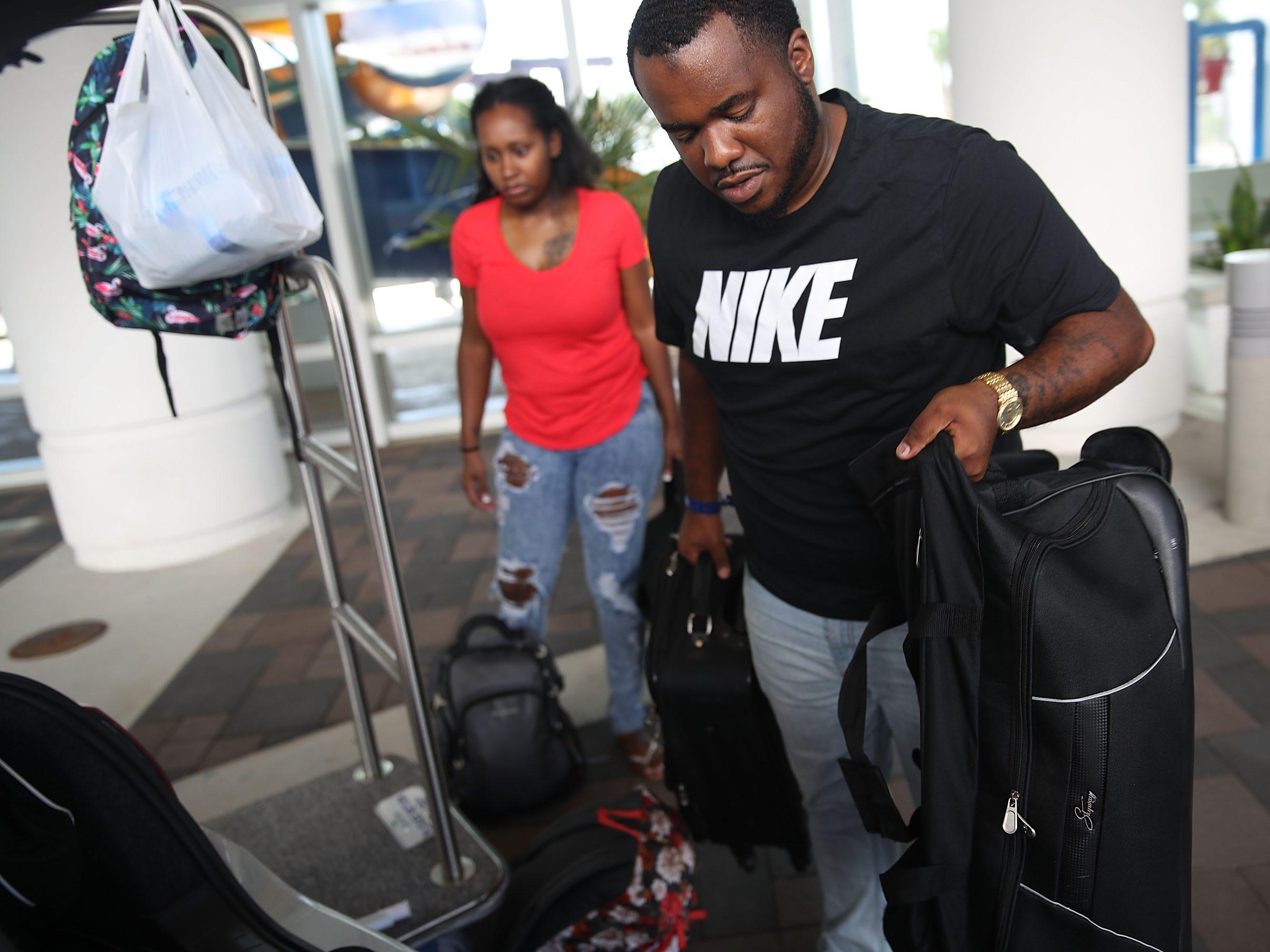 MYRTLE BEACH, SC - SEPTEMBER 11:  Marcus Thurston and his wife Shenae Thurston cut short their vacation and evacuate the South Bay Inn and Suites hotel ahead of the arrival of Hurricane Florence on September 11, 2018 in Myrtle Beach, South Carolina. Florence is expected to make landfall by late Thursday to near Category 5 strength along the Virginia, North Carolina and South Carolina coastline.  (Photo by Joe Raedle/Getty Images) ORG XMIT: 775225768 ORIG FILE ID: 1031243048