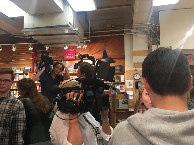 """A Finnish television station interviews a customer waiting to buy a copy of """"Fear: Trump in the White House."""""""