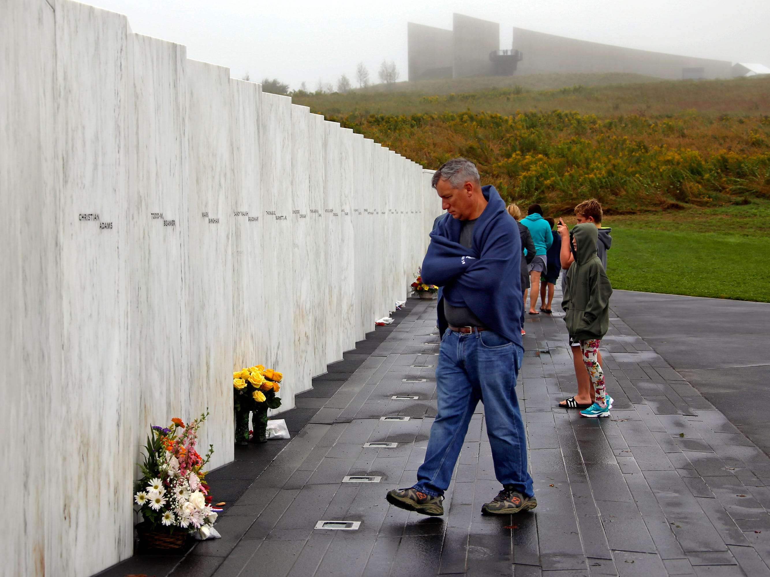 Visitors to the Flight 93 National Memorial in Shanksville, Pa., view the Wall of Names on Monday, Sept. 10, 2018, as the nation marks the 17th anniversary of the Sept. 11, 2001 attacks. The Wall of Names contains the names of the 44 people who died in the crash of Flight 93 on Sept. 11. (AP Photo/Gene J. Puskar) ORG XMIT: PAGP103
