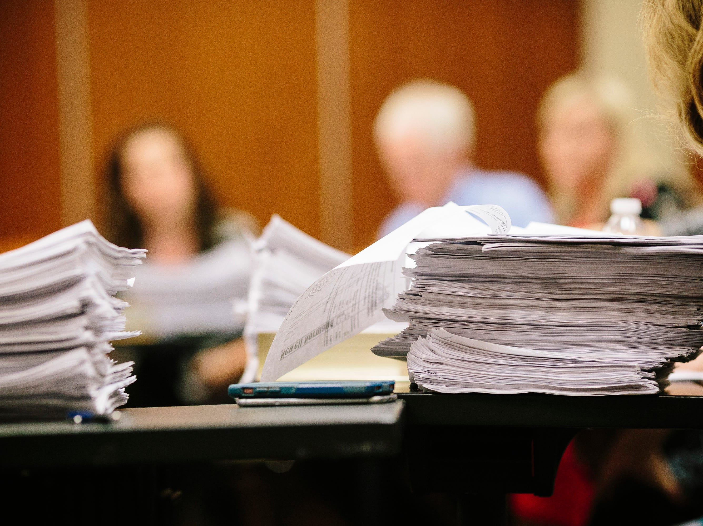Stacks of case files during a meeting of the Louisiana Crime Victims Reparations Board on May 1, 2017 in Baton Rouge, Louisiana.