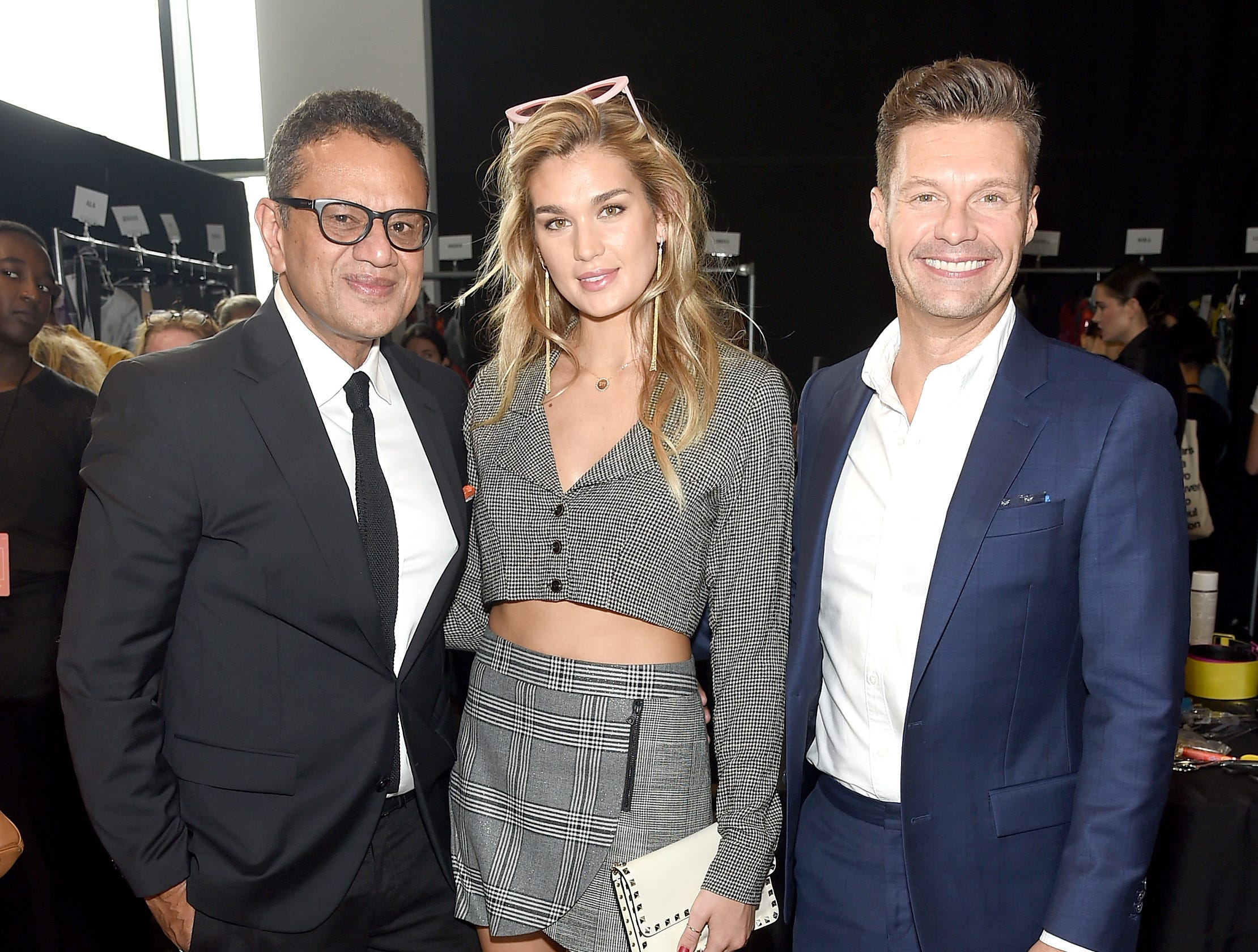 NEW YORK, NY - SEPTEMBER 11:  Designer Naeem Khan, model Shayna Taylor and Ryan Seacrest pose backstage for Naeem Khan during New York Fashion Week: The Shows at Gallery I at Spring Studios on September 11, 2018 in New York City.  (Photo by Jamie McCarthy/Getty Images for NYFW: The Shows) ORG XMIT: 775216898 ORIG FILE ID: 1031609848