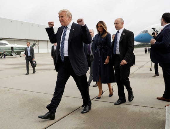 President Donald Trump and first lady Melania Trump arrive at John Murtha Johnstown-Cambria County Airport in Johnstown, Pa., Tuesday, Sept. 11, 2018. Trump will be speaking during the September 11th Flight 93 Memorial Service in Shanksville, Pa.