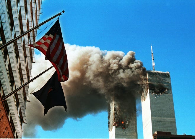 Smoke pours from the World Trade Center after being hit by two planes September 11, 2001 in New York City.  (Photo by Craig Allen/Getty Images)