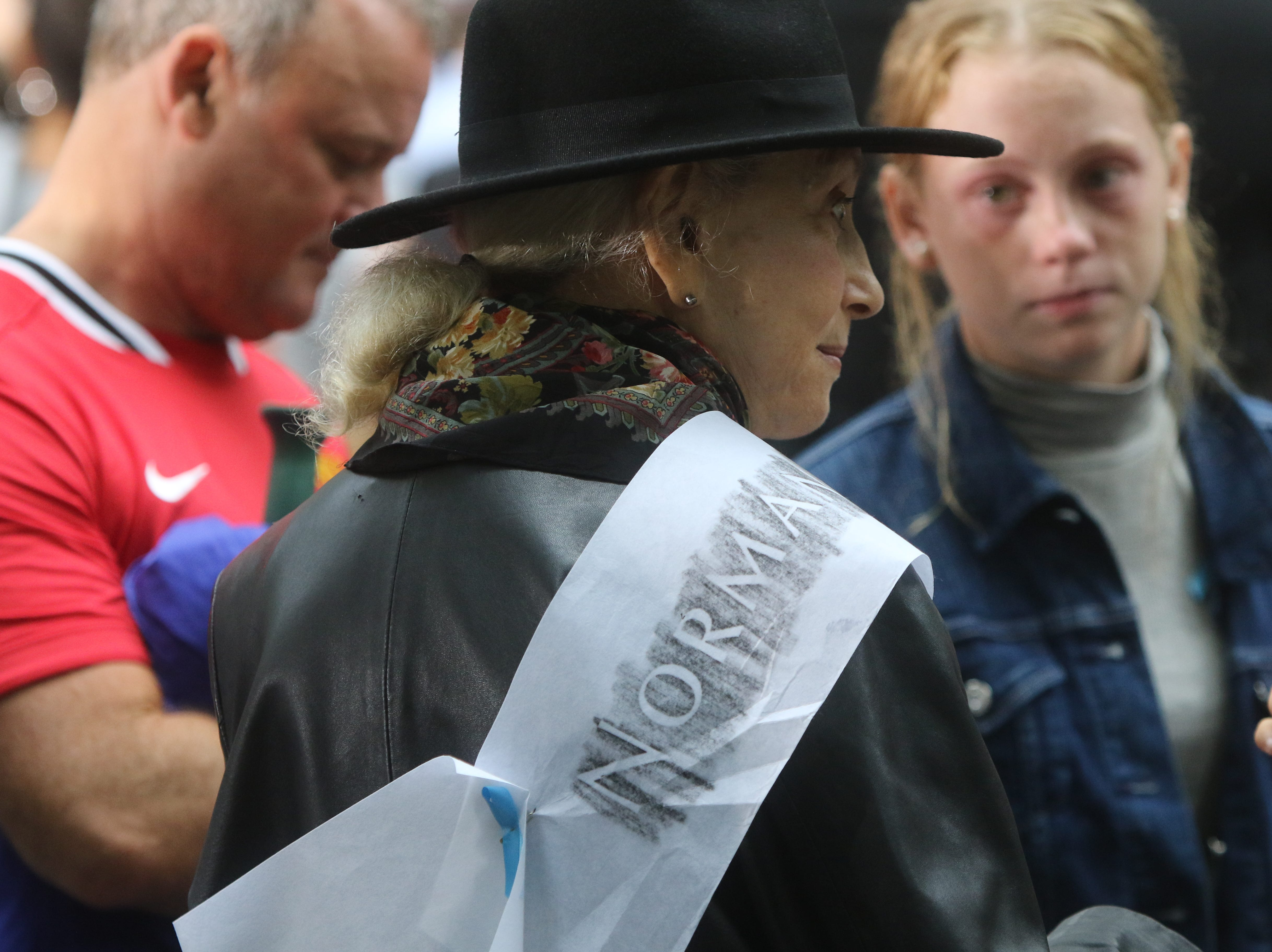 Ann Rossener drapes an etching with her son's name during the ceremonies at the National September 11 Memorial on Sept. 11, 2018 in New York.