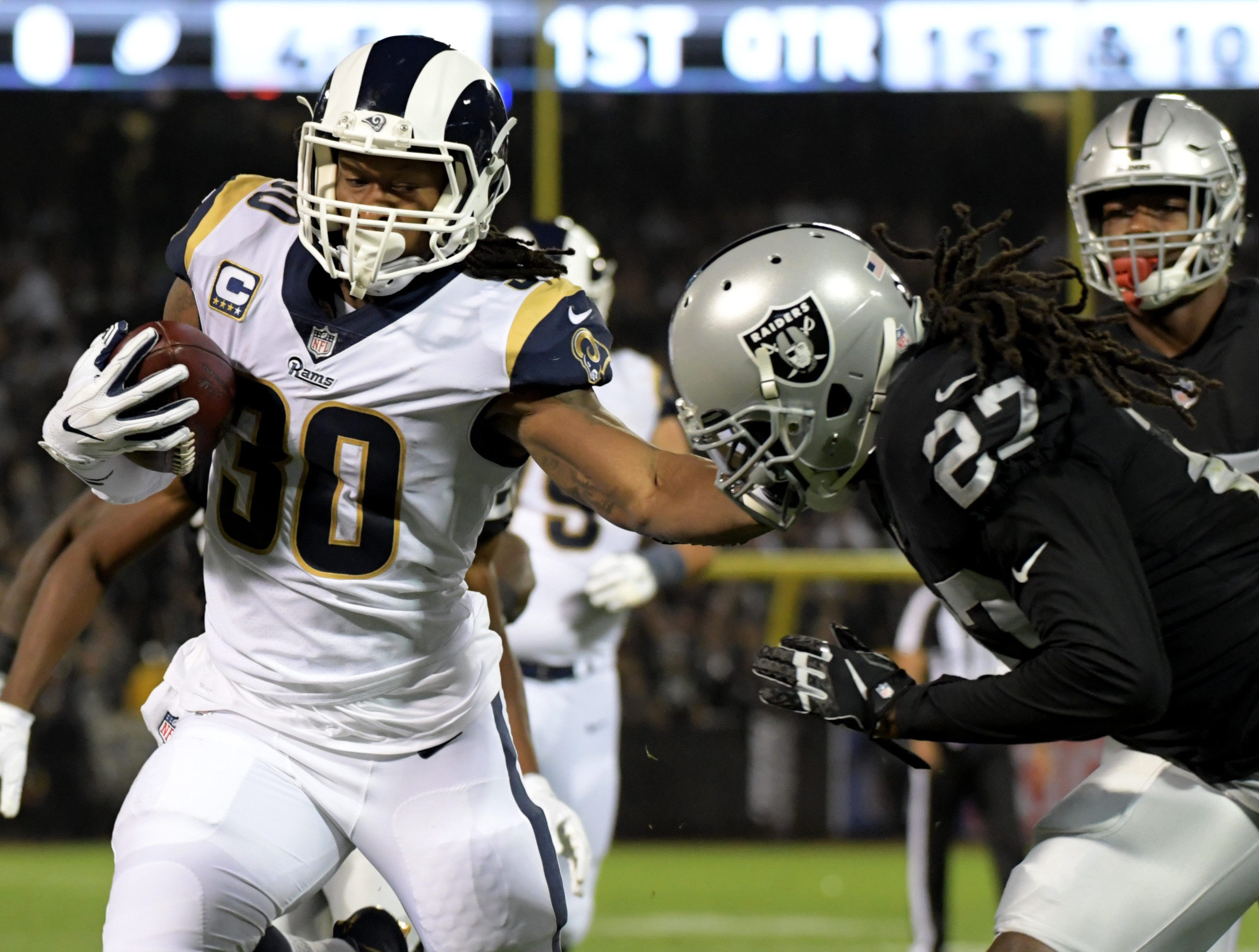 Los Angeles Rams running back Todd Gurley stiff arms Oakland Raiders defensive back Reggie Nelson during the first half at the Oakland-Alameda County Coliseum.