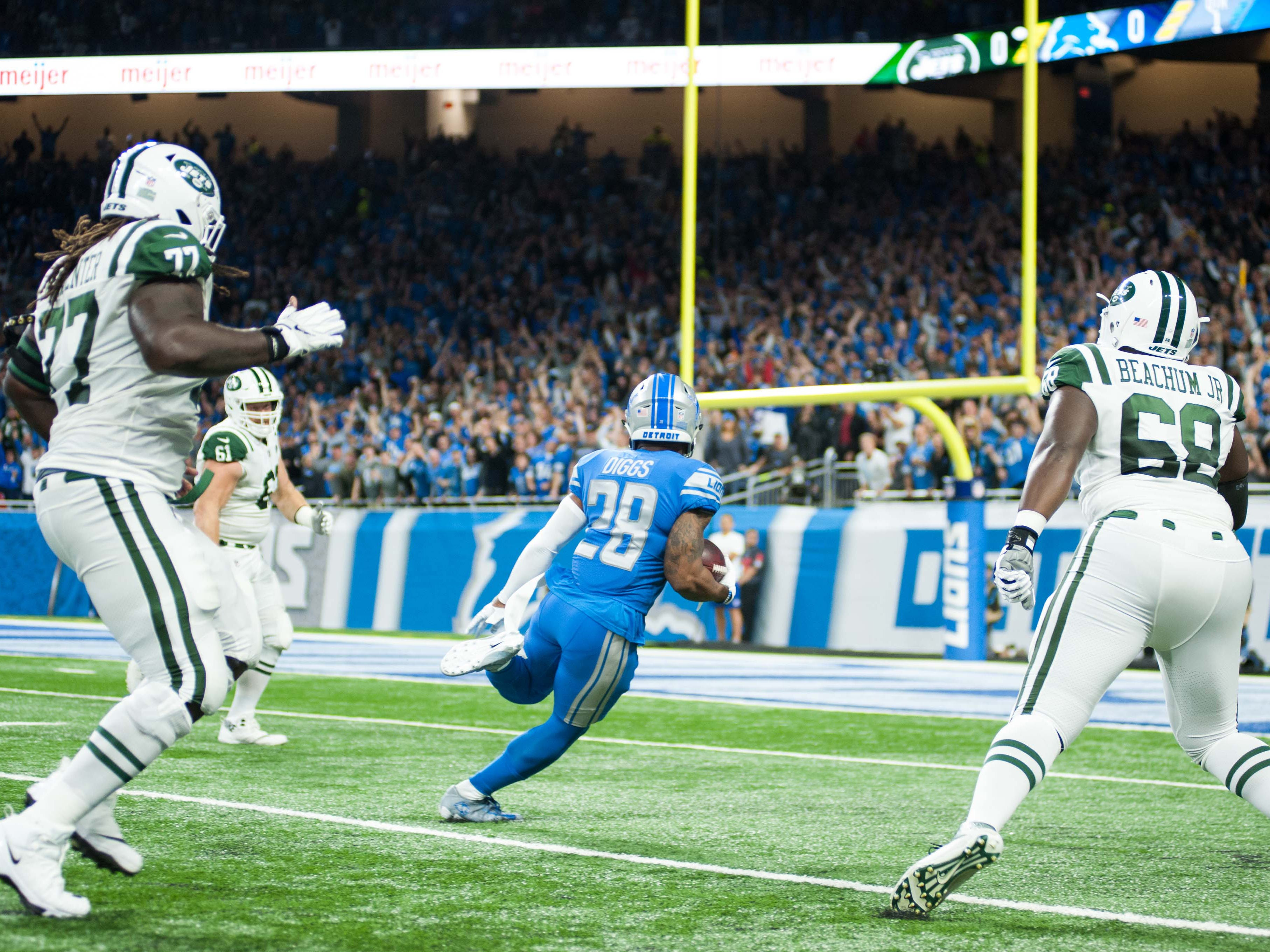 Detroit Lions cornerback Quandre Diggs makes an interception and scores a touchdown against the New York Jets. The pick-six came on Jets QB Sam Darnold's first career pass attempt.