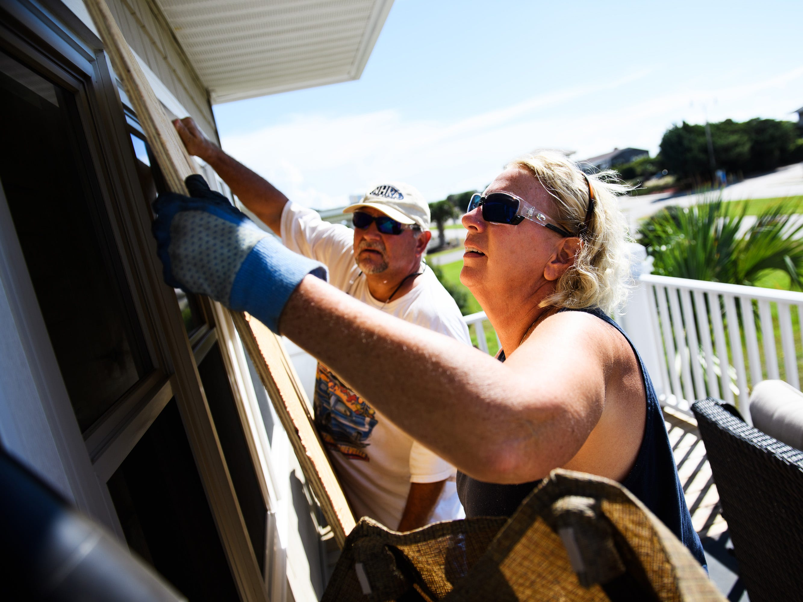 Sept. 11, 2018; North Myrtle Beach, SC, USA; Angie Travis and her husband Jeff place large piece of plywood over a window on their vacation home as they prepare for Hurricane Florence. Mandatory Credit: Josh Morgan/The Greenville News via USA TODAY NETWORK ORIG FILE ID:  20180911_ajw_usa_031.jpg