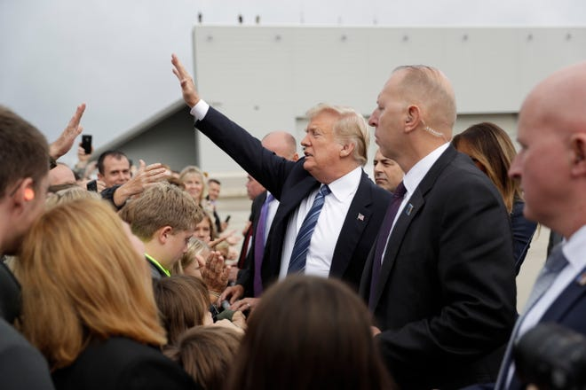President Donald Trump and first lady Melania Trump greet people as they arrive at John Murtha Johnstown-Cambria County Airport in Johnstown, Pa., Tuesday, Sept. 11, 2018. Trump will be speaking during the September 11th Flight 93 Memorial Service in Shanksville, Pa. (AP Photo/Evan Vucci) ORG XMIT: PAEV203
