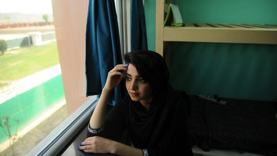Samaneh Nasiri, a student at the American University of Afghanistan, sits in her dorm room. Nasiri survived an attack on the school in 2016.