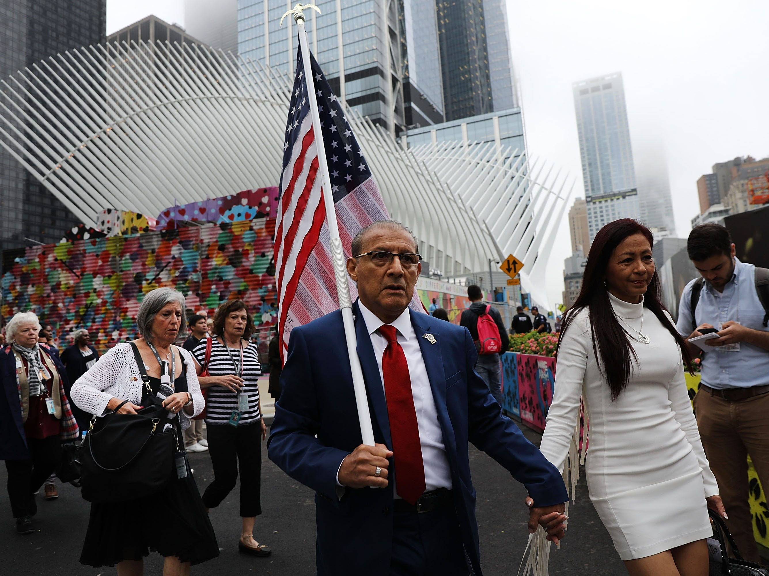 Relatives and friends of victims walk into the World Trade Center site for a morning commemoration ceremony for the victims on Sept.11, 2018 in New York.