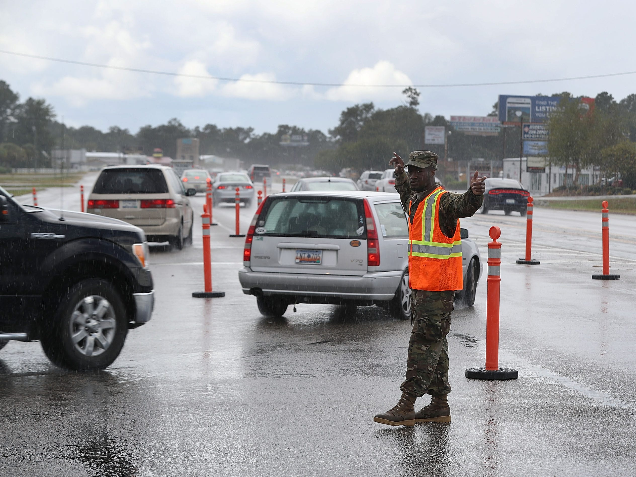 PFC. Traequan Shaw of the  South Carolina National Guard directs traffic onto US 501 as the South Carolina government ordered that traffic use all the lanes on the route leading away from the coast to facilitate the evacuation of people ahead of the arrival of Hurricane Florence on Sept. 11, 2018 in Myrtle Beach, S.C..