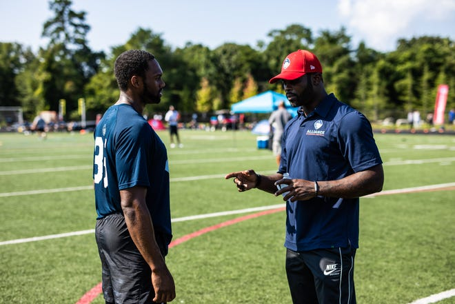 Atlanta offensive coordinator Michael Vick is one of the faces of the Alliance, a start-up league meant to complement the NFL as a spring football showing.