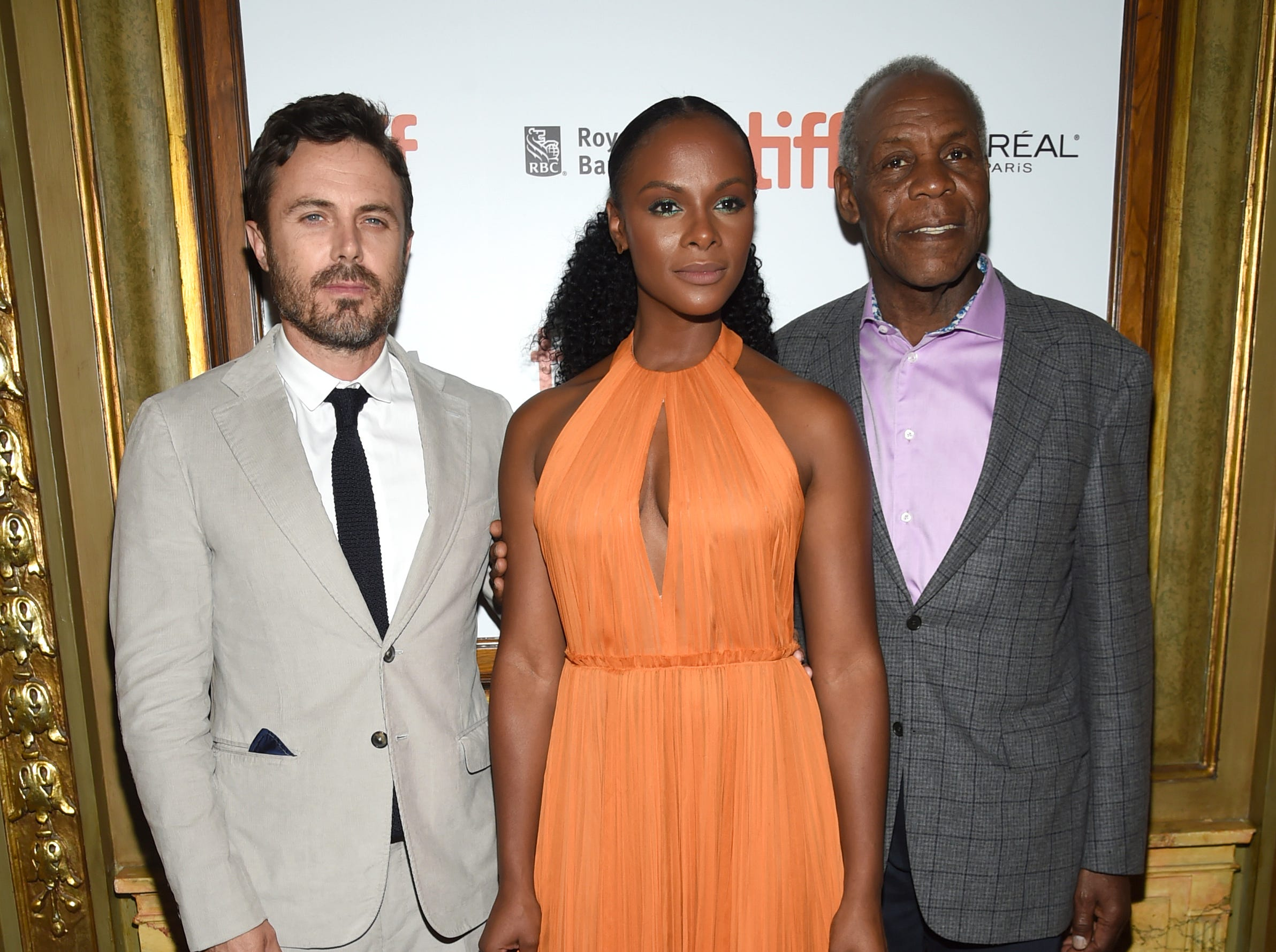 "Casey Affleck, from left, Tika Sumpter and Danny Glover attend the premiere for ""The Old Man & The Gun"" on day 5 of the Toronto International Film Festival at the Elgin Theatre on Monday, Sept. 10, 2018, in Toronto. (Photo by Evan Agostini/Invision/AP) ORG XMIT: CANPM134"
