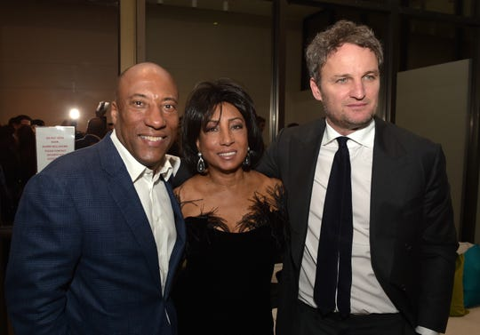 """Byron Allen, CEO, Entertainment Studios, his mother Carolyn Folks and actor Jason Clarke pose at the after-party for the premiere of Entertainment Studios Motion Picture's """"Chappaquiddick"""" at the Samuel Goldwyn Theatre on March 28, 2018 in Beverly Hills, Calif."""