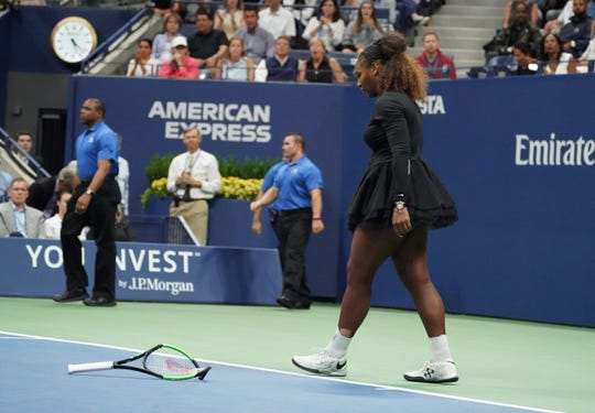 Serena Williams breaks her racquet in frustration in the US Open final against Naomi Osaka.