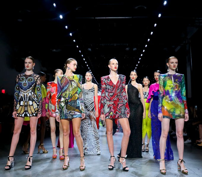 Fashion from the Naeem Khan collection is modeled during Fashion Week, Tuesday Sept. 11, 2018, in New York. (AP Photo/Bebeto Matthews) ORG XMIT: NYBM102