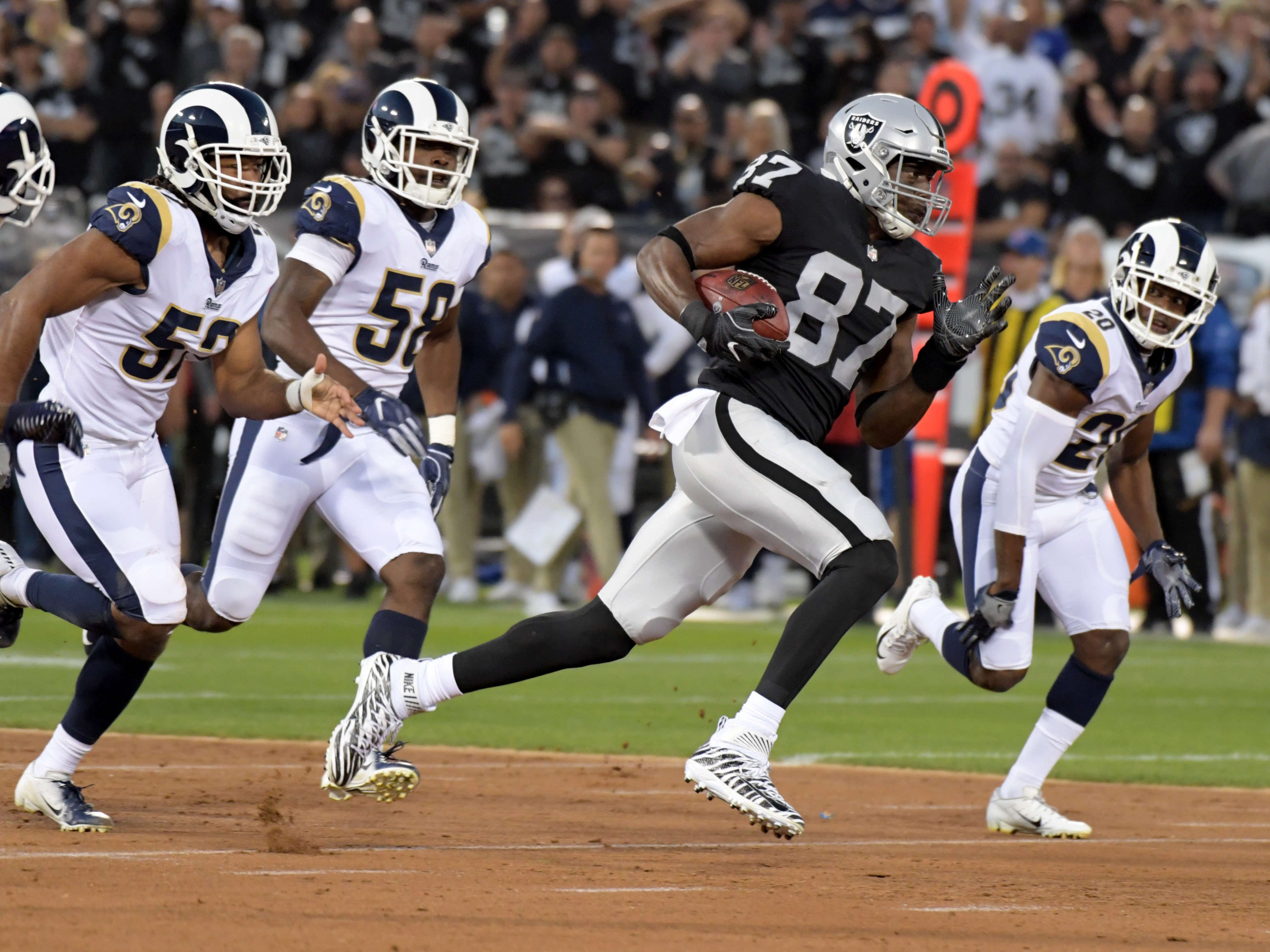 Raiders tight end Jared Cook carries the ball against the Los Angeles Rams.