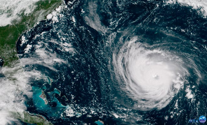 A satellite image taken Sept. 11, 2018, shows Hurricane Florence in the Atlantic Ocean as it threatens the U.S. East Coast.