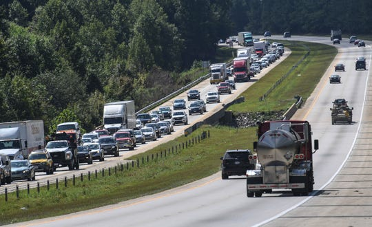 Cars drive slowly away from the coast on I-40 in Garner, N.C. on Tuesday, Sept. 11, 2018.