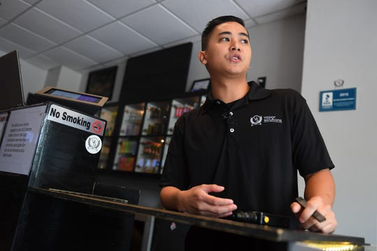Jack Cao, co-owner of Vapor Solutions DMV is shown at his store in Falls Church, VA.