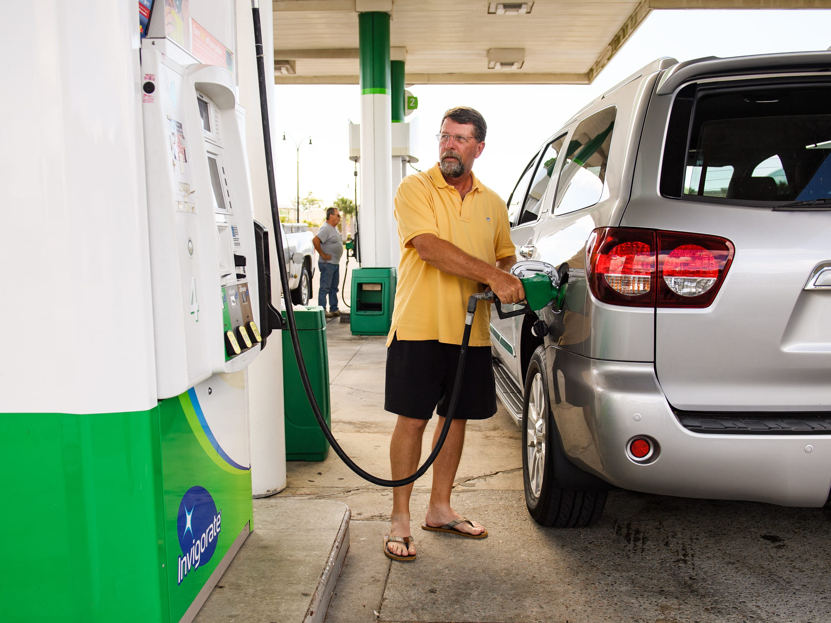 David Fries of North Myrtle Beach fills up his vehicle on Tuesday, Sept. 11, 2018, days before Hurricane Florence is expected to hit the coast of North and South Carolina. Fries said he will be staying at his home with his pets, but his wife and mother in law will be evacuating.  (Via OlyDrop)