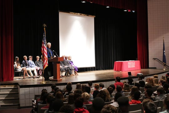 """Principal Karl Carpenter addresses about 400 freshmen at Pineville High School's """"Commitment to Commencement"""" ceremony."""