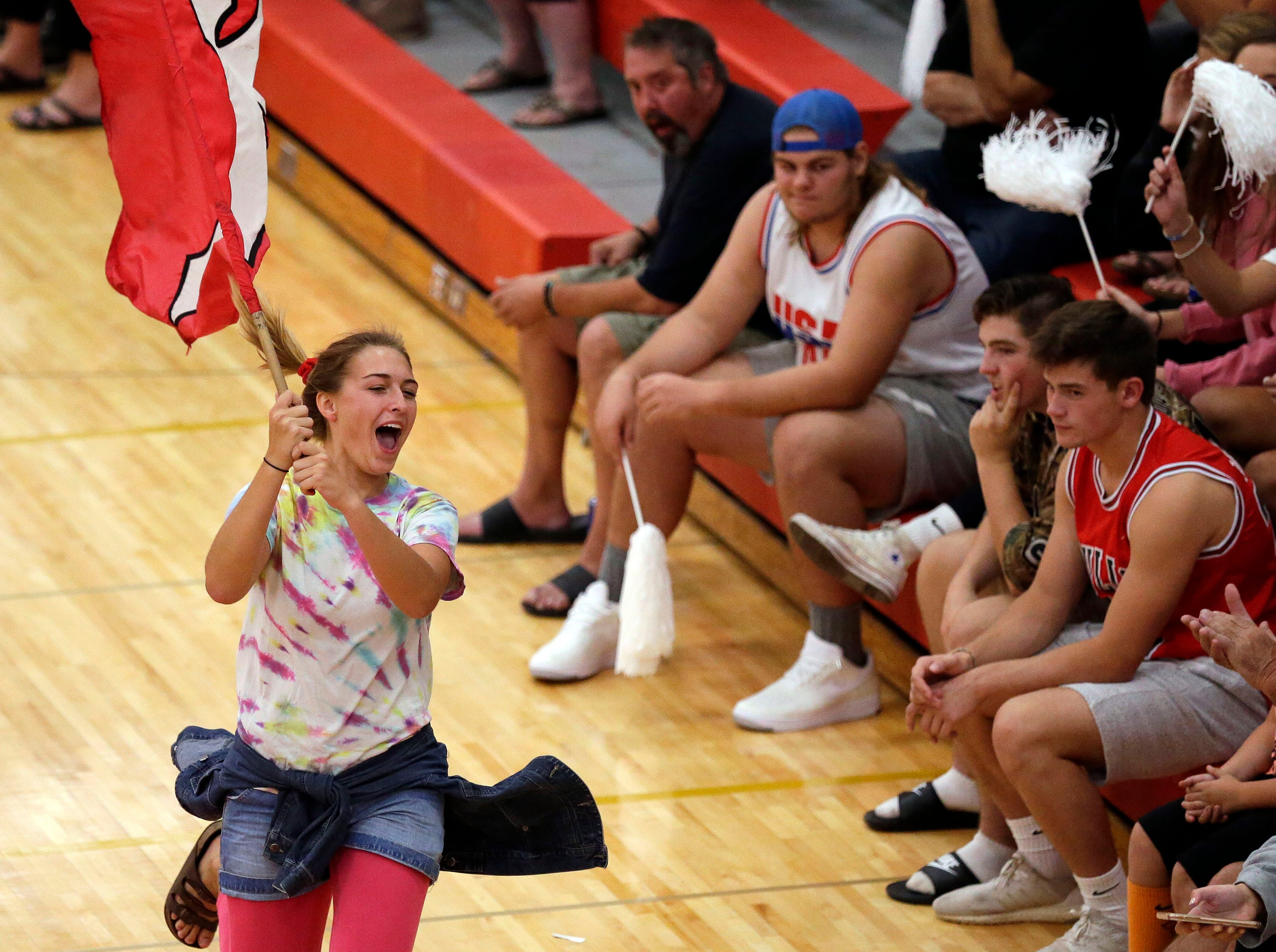 A Kimberly visits the Neenah cheering section during FVA girls volleyball Tuesday, September 11, 2018, at Kimberly High School in Kimberly, Wis.Ron Page/USA TODAY NETWORK-Wisconsin