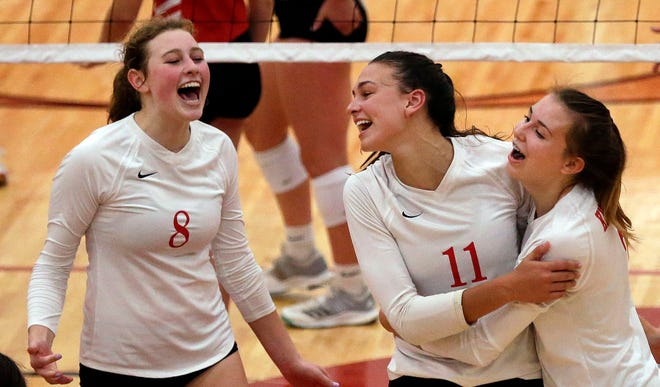 Carlee Doering, left, Maggie Cartwright and Kalli Mau of Kimberly celebrate their win over Neenah in FVA girls volleyball Tuesday, September 11, 2018, at Kimberly High School in Kimberly, Wis. Ron Page/USA TODAY NETWORK-Wisconsin