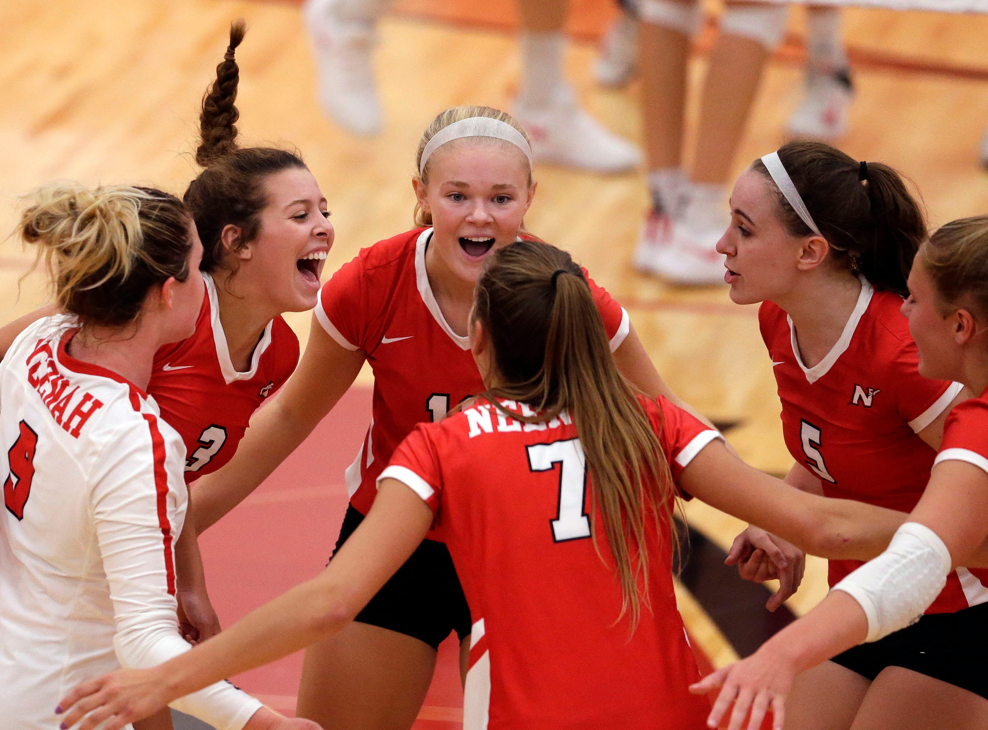 Neenah players celebrate a play against Kimberly in FVA girls volleyball Tuesday, September 11, 2018, at Kimberly High School in Kimberly, Wis.Ron Page/USA TODAY NETWORK-Wisconsin