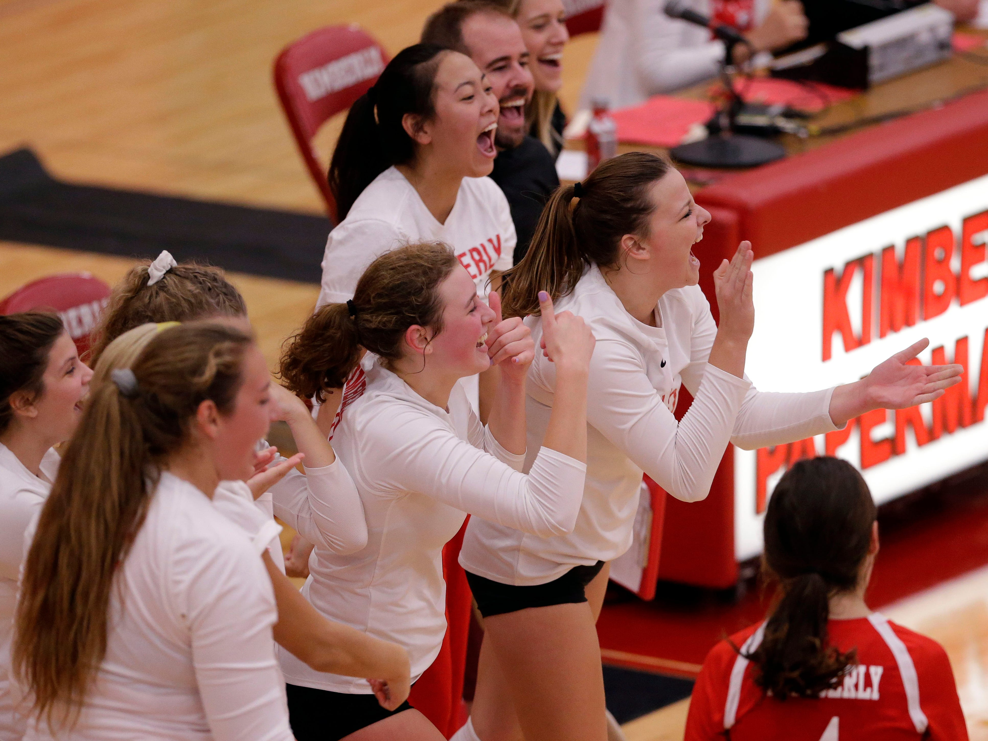 Kimberly players celebrate as they take on Neenah in FVA girls volleyball Tuesday, September 11, 2018, at Kimberly High School in Kimberly, Wis.Ron Page/USA TODAY NETWORK-Wisconsin