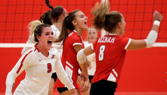 Kayla Kraus,left, of Neenah celebrates a play against Kimberly in FVA girls volleyball Tuesday, September 11, 2018, at Kimberly High School in Kimberly, Wis.