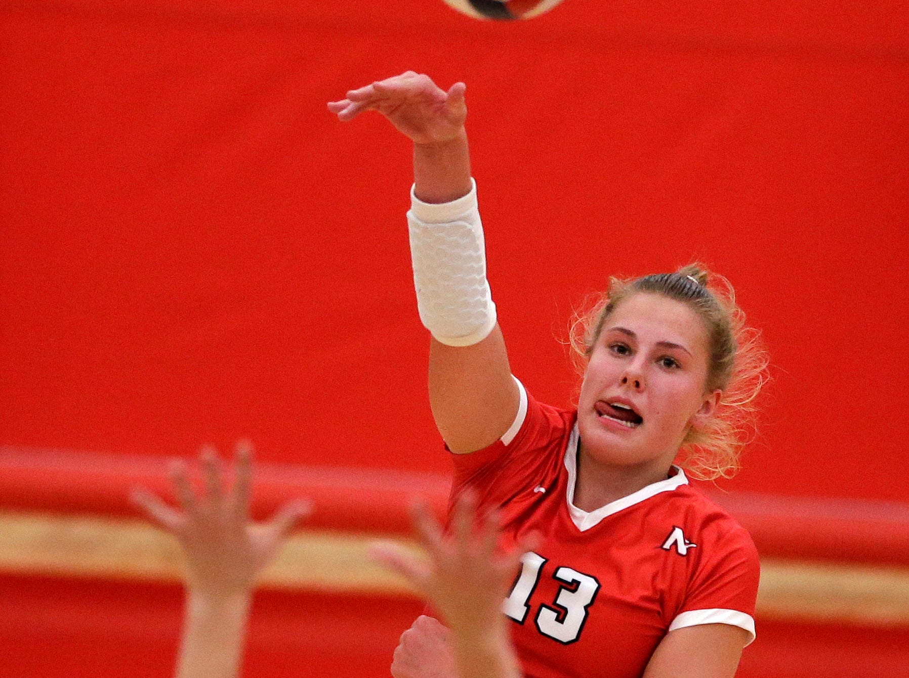 Kiersten Kraus of Neenah hits against Kimberly in FVA girls volleyball Tuesday, September 11, 2018, at Kimberly High School in Kimberly, Wis.Ron Page/USA TODAY NETWORK-Wisconsin