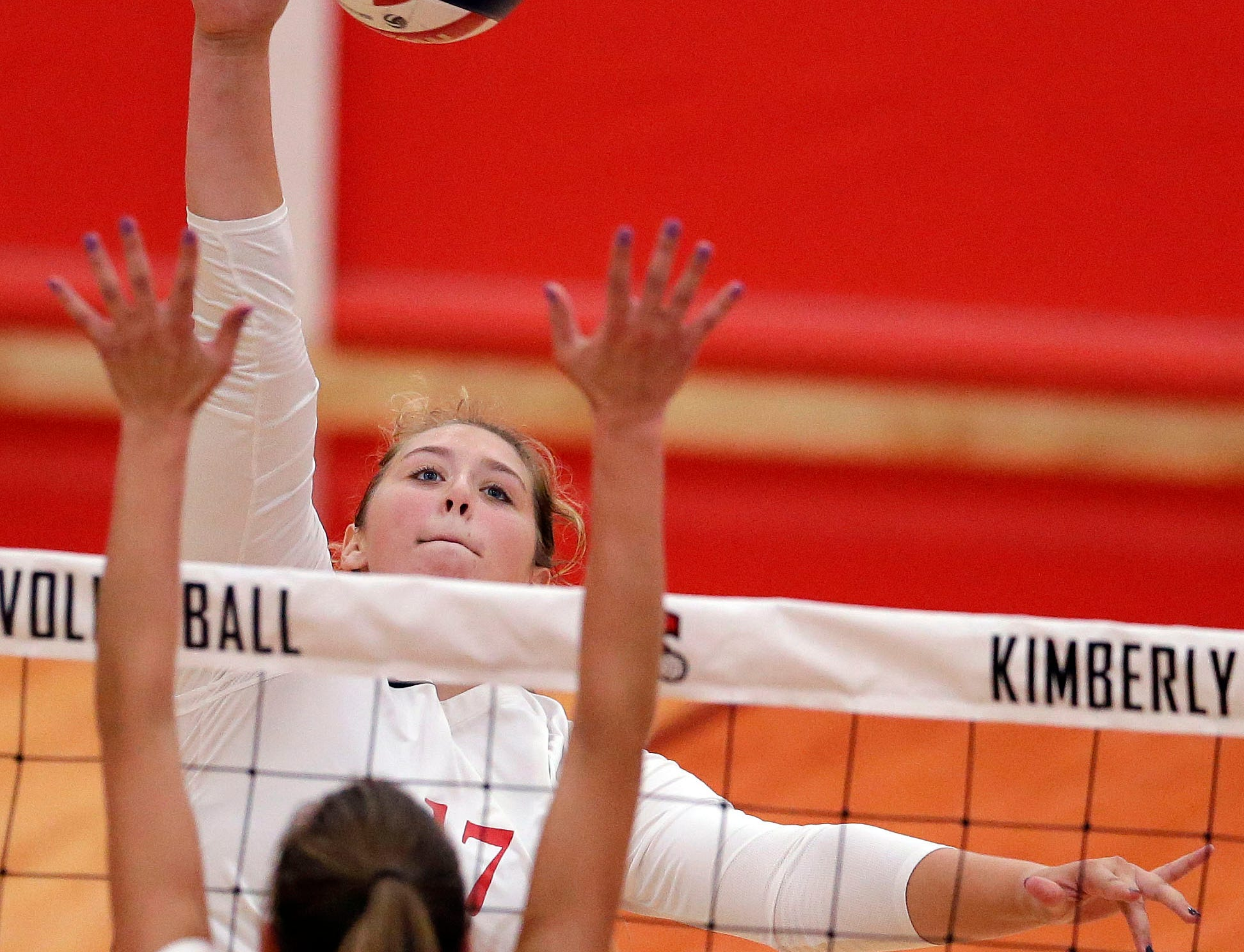 Kaitlyn Schroeder of Kimberly hits over Addison Barnes of Neenah in FVA girls volleyball Tuesday, September 11, 2018, at Kimberly High School in Kimberly, Wis.Ron Page/USA TODAY NETWORK-Wisconsin