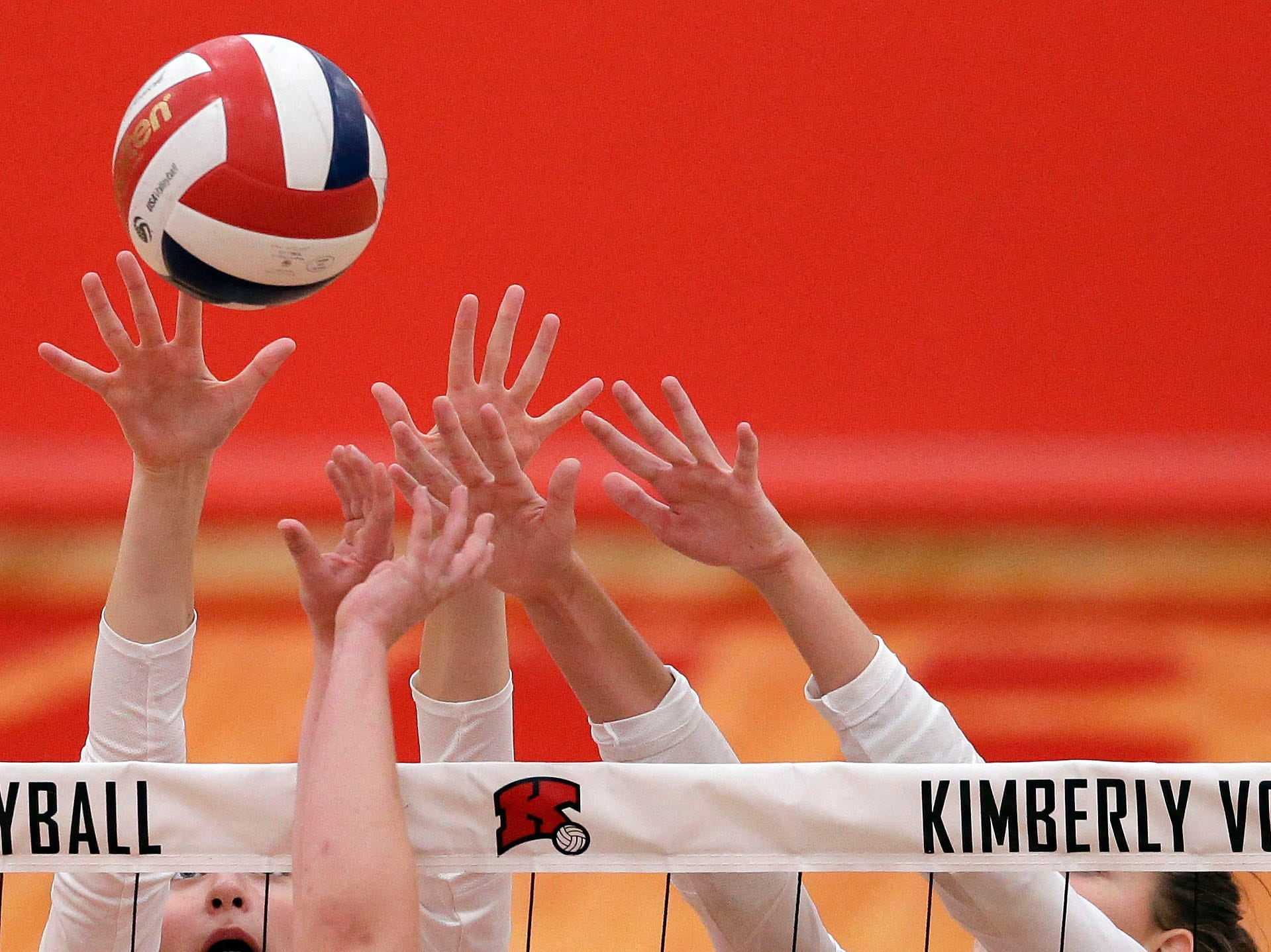Tommy Albers of Neenah, front, and Maddy Schreiber, left, and Courtney Pearson of Kimberly meet at the net in FVA girls volleyball Tuesday, September 11, 2018, at Kimberly High School in Kimberly, Wis.Ron Page/USA TODAY NETWORK-Wisconsin