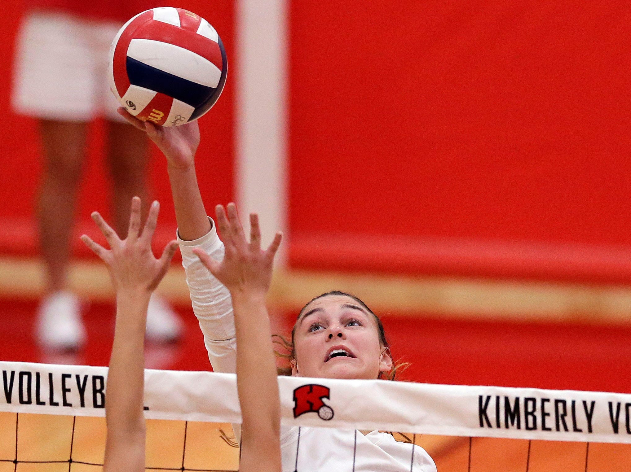Maggie Cartwright of Kimberly gets above Leah Schlafman of Neenah in FVA girls volleyball Tuesday, September 11, 2018, at Kimberly High School in Kimberly, Wis.Ron Page/USA TODAY NETWORK-Wisconsin