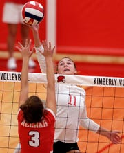 Maggie Cartwright of Kimberly gets above Leah Schlafman of Neenah in FVA girls volleyball Tuesday, September 11, 2018, at Kimberly High School in Kimberly, Wis.