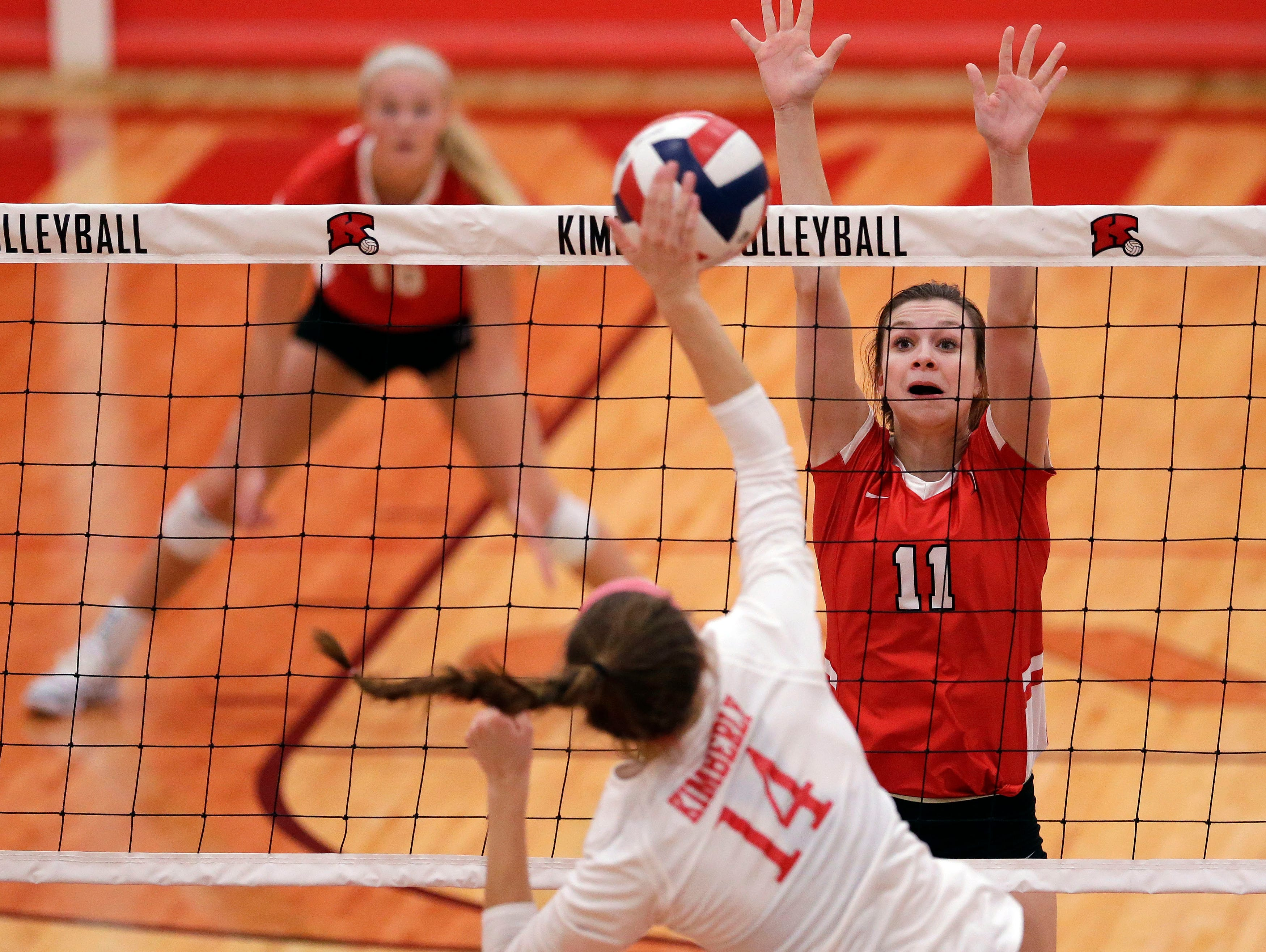 Maddy Schreiber of Kimberly hits as Reagan Obry of Neenah looks to block in FVA girls volleyball Tuesday, September 11, 2018, at Kimberly High School in Kimberly, Wis.Ron Page/USA TODAY NETWORK-Wisconsin