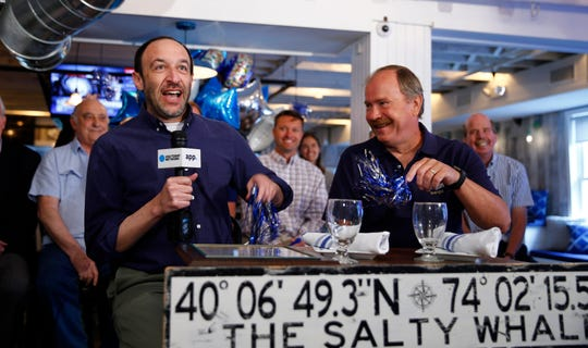 Manasquan Mayor Edward G. Donovan (right) celebrates after his town was named the Best Town at the Jersey Shore announced by reporter Michael Diamond during a facebook live show from the Salty Whale Wednesday, September 12, 2018.